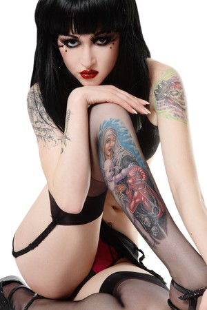 y beautiful brunette with tattooes sitting in white background Stock Photo