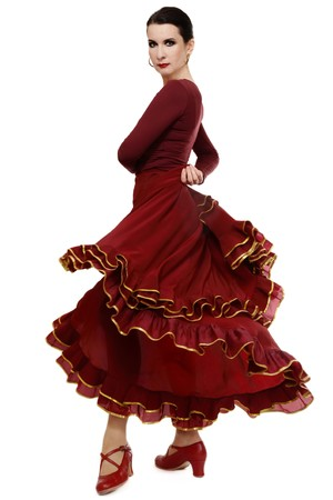 Attractive woman dancing flamenco, over white background
