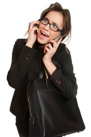 Stressed stylish businesswoman talking by two cellphones over white background photo