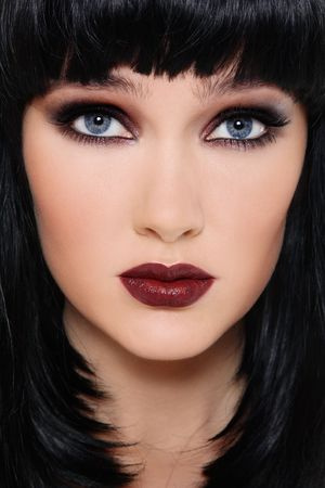 Close-up portrait of beautiful brunette with smoky eyes