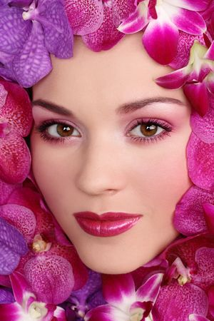 Close-up portrait of beautiful girl with stylish makeup and flowers around her face Stock Photo - 4632710