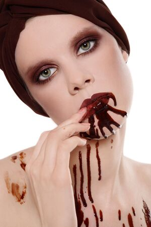 entice: Portrait of woman with beautiful stylish makeup and chocolate on her face Stock Photo