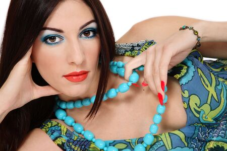 entice: Beautiful exotic brunette with bright makeup and turquoise beeds