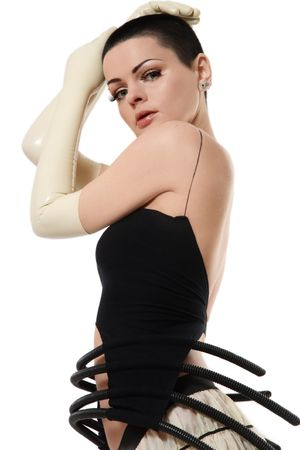 Woman with short haircut in fancy dress and latex gloves over white background