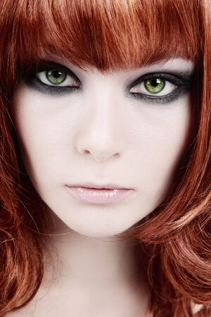 smoky eyes: Close-up portrait of redhead girl with smoky eyes