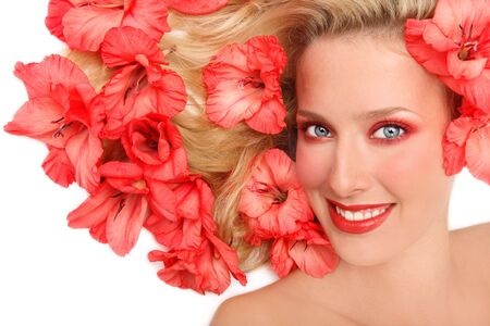 Beautiful smiling girl lying on white background with pink flowers roses in her blond hair Stock Photo - 4695211