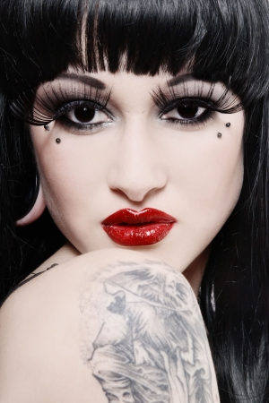piercing: Black and white colored portrait of woman with false eyelashes and red lips