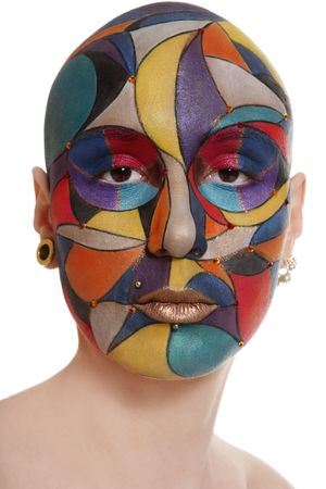faceart: Portrait of skinhead woman with bright faceart over white background Stock Photo