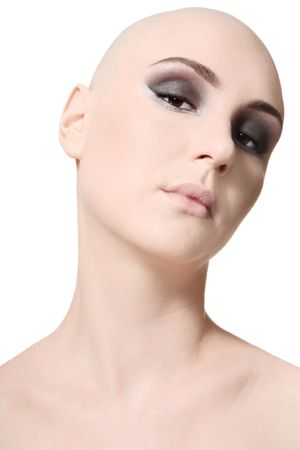 Portrait of beautiful skinhead girl with trendy makeup photo