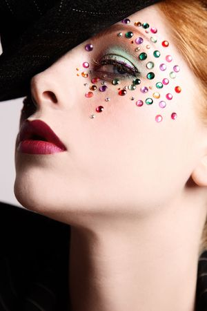 Close-up portrait of beautiful redhead girl with fancy makeup Stock Photo