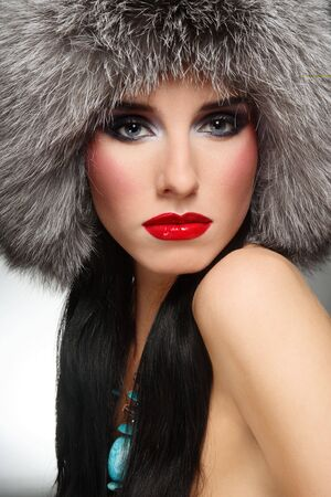 Portrait of beautiful glamorous brunette in stylish fur hat photo