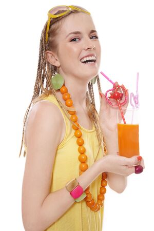 Beautiful slim young laughing girl with glass of carrot juice over white background photo
