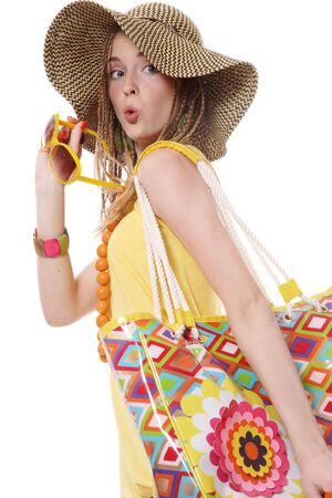 Beautiful slim young stylish girl with yellow sunglasses and bright bag photo
