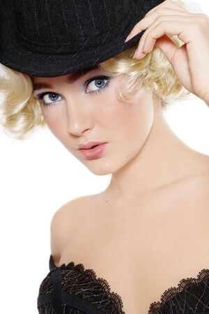 Portrait of young beautiful blond girl in hat and sexy bra photo