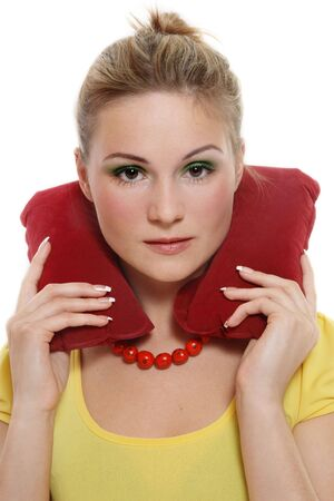 white pillow: Attractive young woman with travel headrest pillow