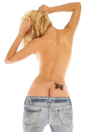 Back of slim sexy tanned girl in blue jeans with butterfly painted on her right buttock