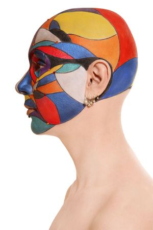 faceart: Portrait of skinhead woman with colorful fancy faceart over white background Stock Photo
