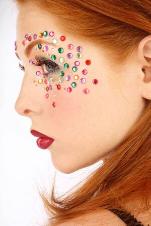 Close-up portrait of beautiful redhead girl with fancy makeup photo