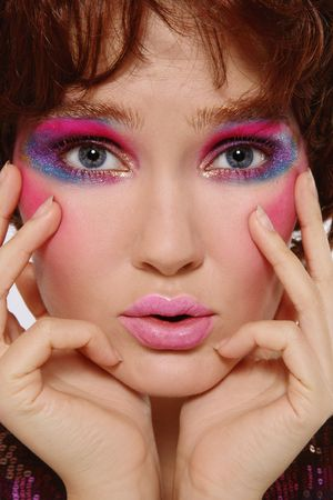 Close-up portrait of beautiful girl with crazy disco makeup photo