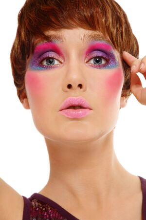 Portrait of beautiful girl with stylish haircut and crazy disco makeup photo