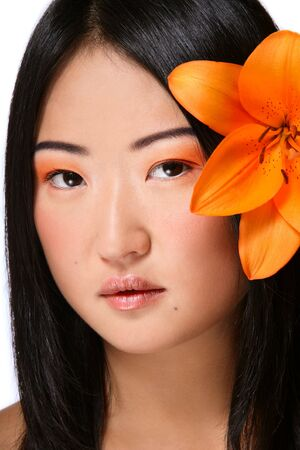 Portrait of beautiful young asian girl with bright flower Stock Photo - 5662384