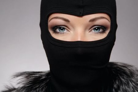 allure: Head of woman with beautiful eyes in black mask