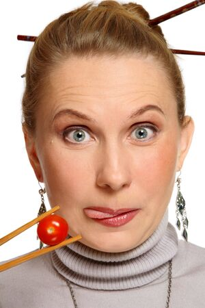 clowning: Portrait of attractive woman with hungry expression and chopsticks