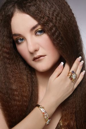 naildesign: Attractive young woman with long curly hair and stylish make-up