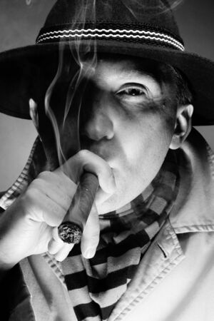 man smoking: Black and white old-fashioned portrait of man smoking cigar