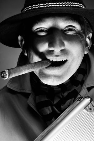 Black and white old-fashioned portrait of smiling man with cigar photo