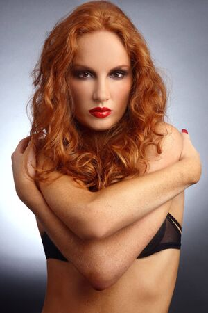 Slim beautiful young woman with red curly hair Stock Photo - 6058753