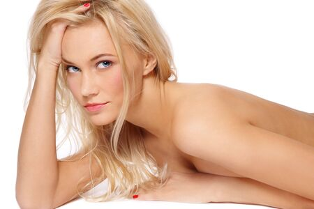 Beautiful slim tanned sexy blonde lying on white background Stock Photo - 6108775