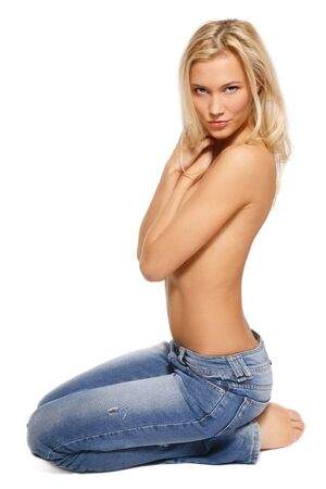 Beautiful slim sexy blonde girl in jeans sitting on white background Stock Photo