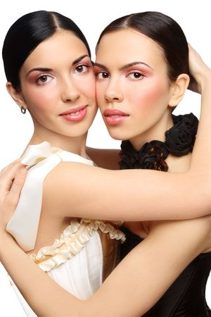 Two beautiful slim sexy young girls with clear pink make-up photo