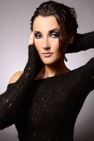 Portrait of young beautiful tanned brunette with stylish make-up and hairstyle Stock Photo - 6428200