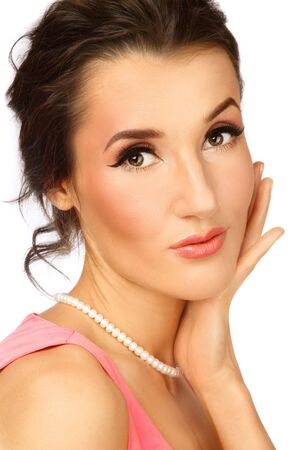 Portrait of young beautiful woman with stylish coral make-up touching her face Stock Photo - 6428281