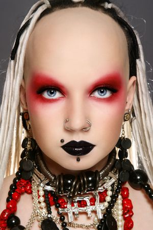 freaks: Portrait of stylish freaky girl with white dreads and fancy make-up