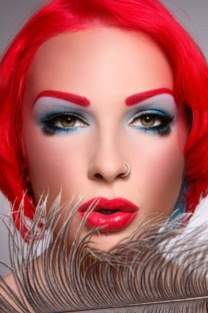 Close-up portrait of beautiful young redhead woman with fancy make-up and piercing Stock Photo - 6474771