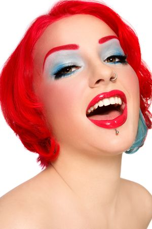Portrait of young beautiful redhead joyful laughing girl with fancy make-up  photo