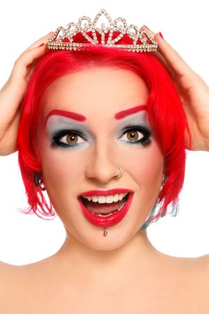 Portrait of young beautiful redhead joyful crying girl with fancy make-up and diadem in hands photo