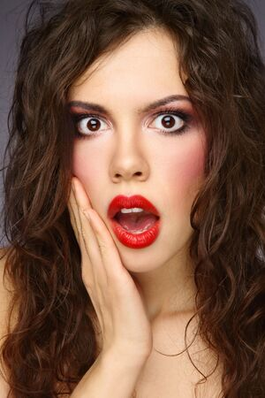Portrait of young beautiful stylish girl with curly hair and shocked expression Stock Photo - 6523151