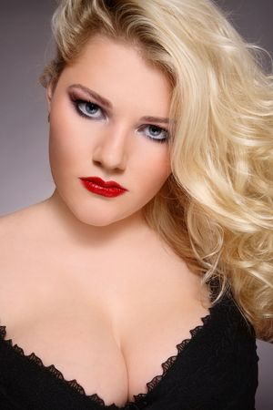 Portrait of beautiful blond plus-size girl with stylish make-up and hairstyle in sexy lingerie photo