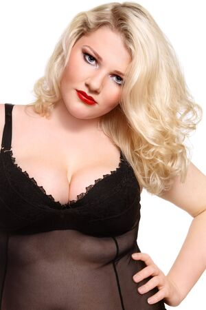 Beautiful blond plus-size girl with stylish make-up and hairstyle in sexy lingerie photo