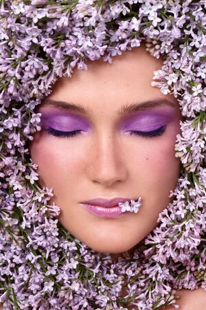 Portrait of beautiful girl with stylish makeup and lilac around her face Stock Photo - 6559761