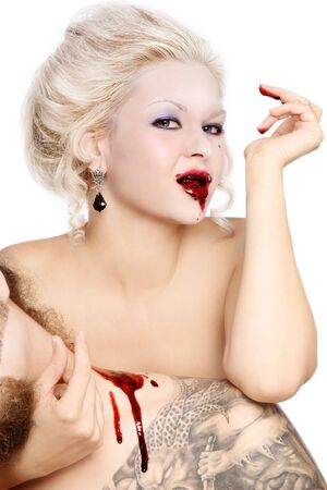 bloodsucker: Portrait of blond woman vampire with bloody mouth  Stock Photo