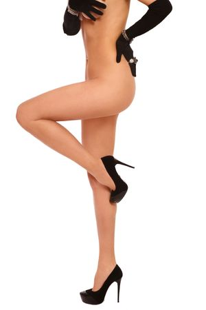 Torso and legs of slim sexy naked woman in black gloves and stilettos on white background