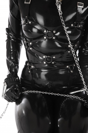 catsuit: Torso of woman in black latex catsuit and body harness with chain