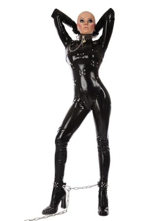 catsuit: Skinhead woman in black latex catsuit and collar with lead over white background Stock Photo