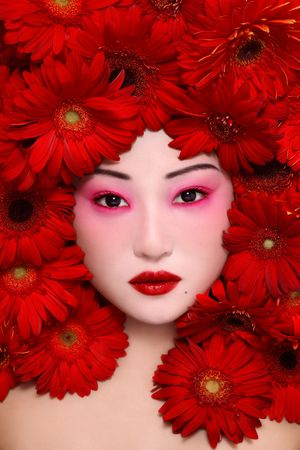 kabuki: Beautiful young asian girl with stylish make-up and red flowers around face