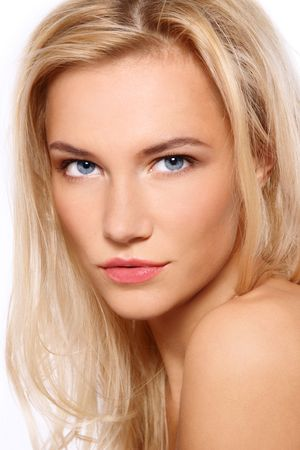 Portrait of beautiful blonde tanned blue-eyed scandinavian girl with clear make-up